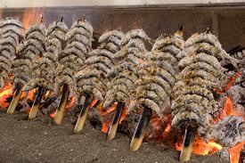 Espetos, tipicos de Malaga, a mi no me gusta el pescado, pero mi mujer se pondra las botas