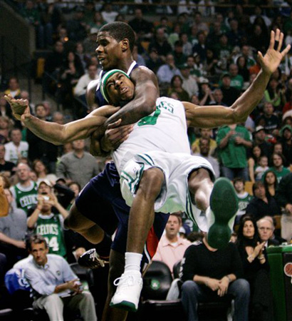 Boston Celtics guard Rajon Rondo, front, is tackled by Atlanta Hawks forward Marvin Williams on a drive to the basket in the second half of Game 7 of an NBA first-round playoff basketball series in Boston, Sunday, May 4, 2008.  Williams was ejected on the play. (AP Photo/Charles Krupa)